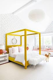 Yellow four poster bed frame and polka-dot wallpaper. Love the color ...