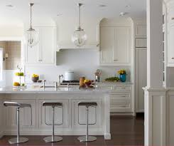 coastal kitchen photo in new york with an undermount sink recessed panel cabinets