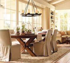 country dining room ideas with rustic chandelier and traditional area rug