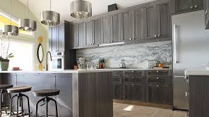 Dark gray kitchen cabinets with marble backsplash