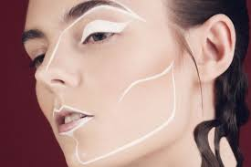 a make up model with white lines on face