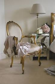 our beautiful armchair finished in gold gilt and gold silk this chair will add elegance in any room the chair es on castors for ease of movement