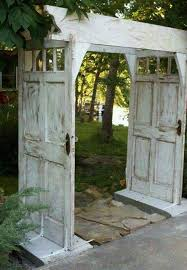 gardening and outdoor decor make an arbor walkway using salvaged doors these are the best upcycled repur