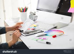 Graphic Designer At Desk Young Handsome Graphic Designer Using Graphics Stock Photo