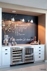 Miami Townhouse Beverage coolers and additional storage are tucked into a  nook where blackboard paint and