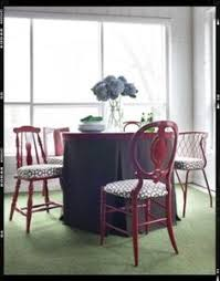 mismatched chair styles brought together with mon colors and fabrics adore this idea for antique kitchen chairs with bright colors and a funky print