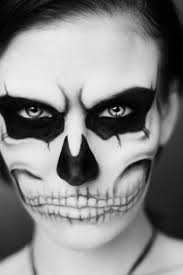 scary face paint idea women skull black white