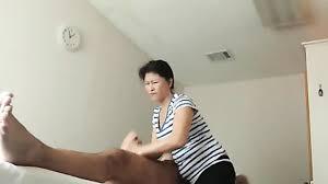 Older asian masseuse handjob