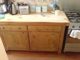 this area of the kitchen featured a butchers block worktop over a cupboard