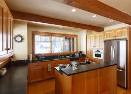 spacious high quality open plan kitchen with exposed beams ceiling wood cabinets