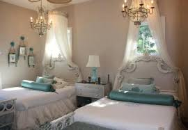 we think that s definitely true of the unusual twin chandeliers in this beautiful bedroom for two