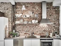 kitchen with brick backsplash