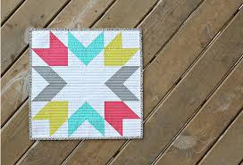 Mini Quilts: 10 Fresh Ideas to Inspire & starburst mini quilt on wood background Adamdwight.com