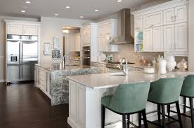 kitchen cabinet range hood design. inspiration for a contemporary kitchen remodel in calgary with stainless steel appliances, granite countertops and cabinet range hood design