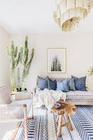Image Navy Blue Living Room With Light Neutral Walls Printed Blue Rug Large Cacti Reclaimed Wood Table And Woven Armchair Pinterest Inside Striking Bay Area Home With Calicool Vibes Living Rooms