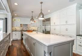 gorgeous kitchen features floor to ceiling cabinets painted white benjamin moore simply white surrounding a stainless steel two door refrigerator facing a
