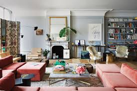 in the living room of jenna lyons s soho loft a vintage milo baughman sofa covered in pierre frey velvet a paul mccobb coffee table with a custom marble