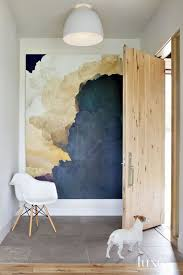 abstract full size wall painting wooden floor white dog wooden chair white top large tile floor round bowl shape ceiling lamp shade back to the proper ways