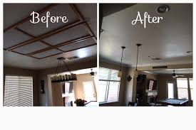 removed recessed fluorescent lighting and added 6 can lights and 3 drop lights kitchen remodel