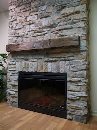 stone veneer fireplace instead of wood mantle make a rock shelf