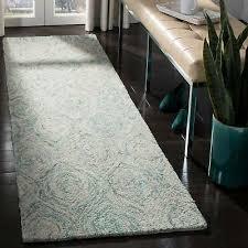 safavieh handmade ikat ivory sea blue wool rug 2 3