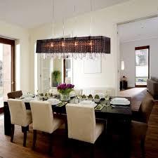 dining room area black ceramic floor traditional palm fiber broom six white shade crystal chandelier