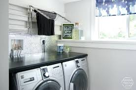exotic laundry room come see this modern remodel featuring open shelving