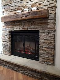 stone fireplaces with wood mantels. room traditional with robinson veneer brick backsplash next to faux stone fireplace alongside undercabinet electrical plugs and reclaimed wood mantel fireplaces mantels a