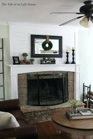 fireplace mantels with tv above decorating ideas mantel decor inspiration with green garland also white mantel