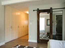 custom sliding door in the master bedroom made from black iron pipe and a salvaged solid wood antique door