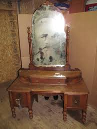 brown wooden vanity table with mirror and storage drawer placed on