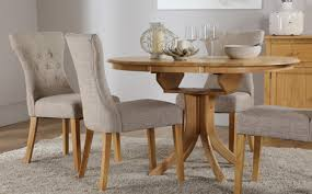 cream compact extending dining table: hudson round extending dining table amp  chairs set bewley oatmeal