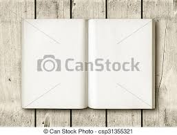 open book on a white wood table csp31355321