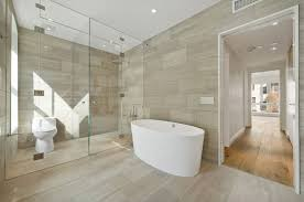 view in gallery bathroom with coordinated wall and floor tile