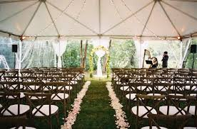 white theme backyard wedding decorations also snow tent and wooden crisscross chairs plus and lovely white flower arrangement