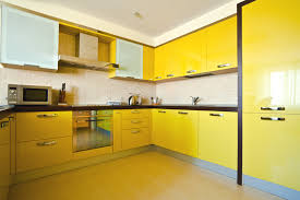 bright yellow modern kitchen with black counters