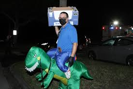 Sarasota County Sheriff's Office hosts Drive-Thru Halloween - Anthony  Langella rode his dinosaur well.   Your Observer