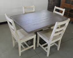 inspiring small dining room decoration using square pedestal light grey wood dining table including white