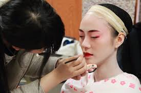 makeup took a bit longer as the makeup base was almost kabuki style where we had to paint the skin on our face and down our neck white