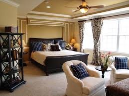 luxurious master bedroom decor with warm paint color and ceiling fan lights also using elegant black and white curtain color
