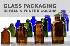 recycled glass bottles jars and candle containers in rich colors are guaranteed to bring a dramatic seasonal look to your fall and winter inspired