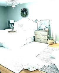 rug under queen bed area for bedroom size rugs sizes master ideas sierra paddle mas