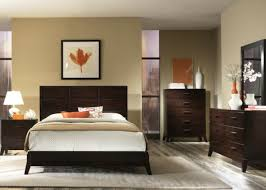 small bedroom set up Orange accents