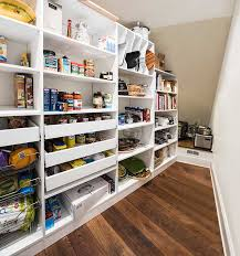 organize deep pantry with sloped ceiling by using under stairs pantry shelving