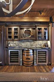 wine barrel bar plans. Blending Rustic Elements With Modern Conveniences, The Bar Area In Kitchen Features Custom Cabinetry, Dual Wine Refrigerators By True And A Sink Basin Barrel Plans