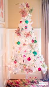 I love the vintage, preppy look of this white Christmas tree. It's decorated  with
