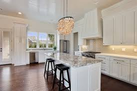white kitchen island with gray granite countertops