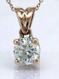 14 kt rose gold solitaire pendant including necklace with one 0 27 ct brilliant cut diamond