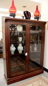 antique two door bookcase with eight shelves pair of hurricane lamps with ruby chemung glass globes