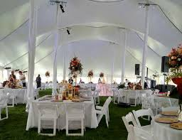 square and round tables under a twin peak tent for a wedding